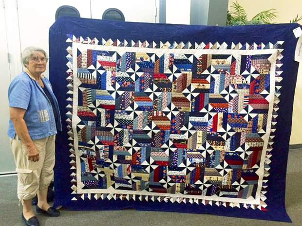 Rosalie Muirhead stands in front of her quilt at the 98th Annual Weld County Fair. She entered her patriotic-themed quilt in the quilting competition on Saturday morning.