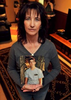 Becky Schneider holds a photo of her son, Justin Drake, who died in a car accident last year. The Justin Drake Memorial Scholarship is aimed at helping agricultural and mechanical students and was established in honor of Drake.
