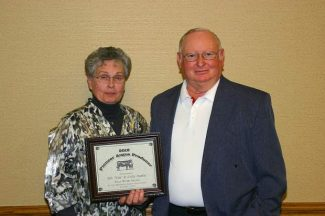 Tim and Judy Stiefel of Four Winds Farms were recognized with The Pioneer Producer Award at the Nebraska Angus Association Annual meeting and Banquet.