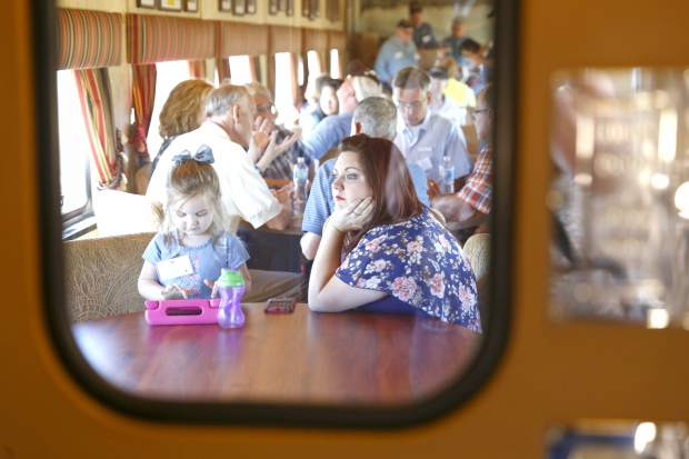 Heather Parker and her daughter Lily, 3, experience their first train ride on The Denver Post Cheyenne Frontier Days train Thursday morning.