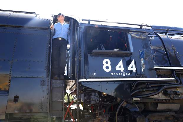 Fireman Ted Schulte looks at the crowd who have come to see The Denver Post Cheyenne Frontier Days train at The Greeley Train Depot on Thursday morning.