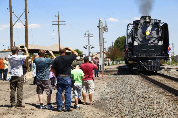 Crowds gather at The Greeley Train Depot to witness and photograph the arrival of The Denver Post Cheyenne Frontier Days train on Thursday morning.