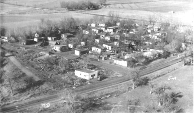 Houses dot the landscape in this arial view of the Spanish Colony north of Greeley. Colonies such as this one were built by Great Western Sugar Company to entice people to work in the sugar beet fields and processing facility.
