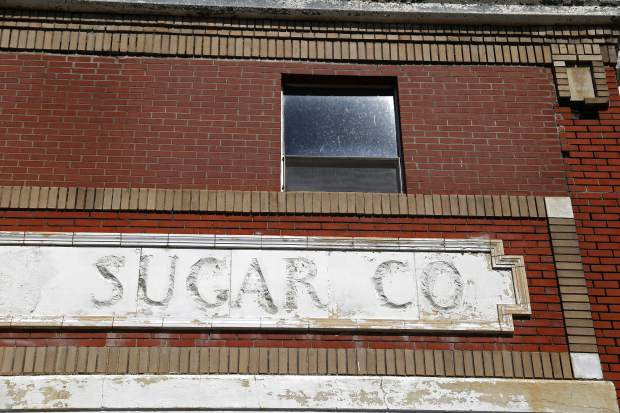 Fainted letters still remain on the factory when it was owned by The Great Western Sugar Company. The building located at US 85 and Weld County Road 2 was bought by Amalgamated Sugar Company in 1985.
