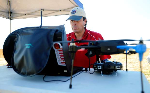 Rob Valentine glances at his computer as he pulls up near-infrared images from previous drone launches last week at a field outside Platteville. Valentine started Precision Aeroworks in April, and has been using the drones for agriculture and commercial mapping.