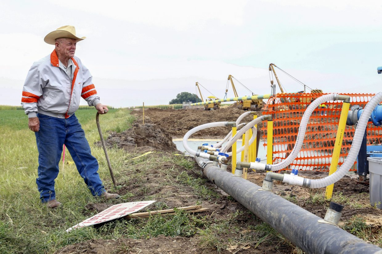 George Maxey looks at the construction for the pipeline that is being installed on his 160-acre property. The construction started in early July and began during harvest season.