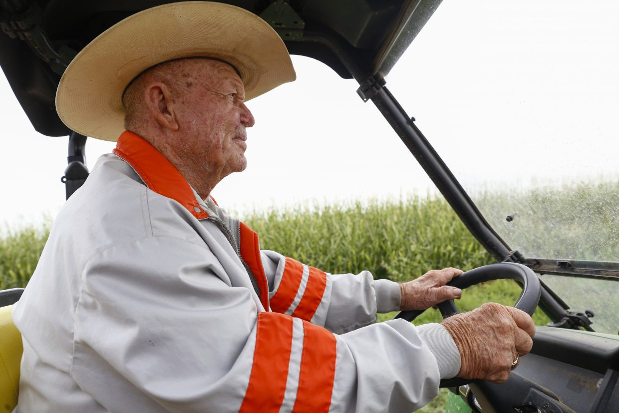 George Maxey drives through alfalfa Aug. 24 on his farm. Maxey says all of the construction has been a huge inconvenience for him and those who work for him.