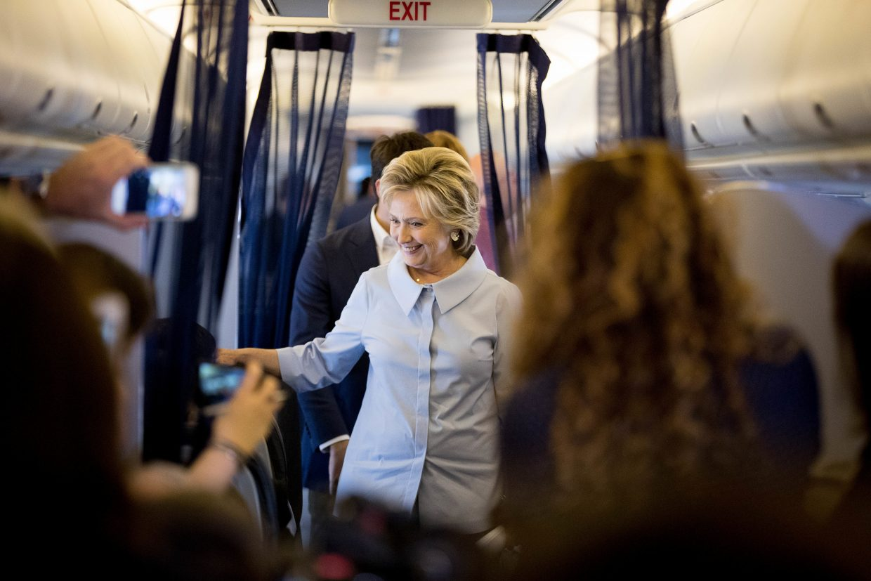 Democratic presidential candidate Hillary Clinton speaks to members of the media on her first flight on a new campaign plane before taking off at the Westchester County Airport in White Plains, N.Y., Monday, Sept. 5, 2016, to travel to Cleveland Hopkins International Airport for Labor Day events. (AP Photo/Andrew Harnik)