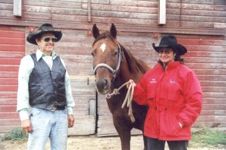 Photo courtesy of June Holeman.Donnie and June Holeman with Sparky in 2005. The super horse has won more than $250,000 in his lifetime.