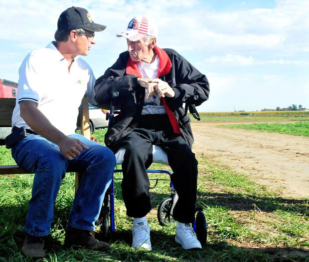 Floyd Mares, 79, talks with Glen Fritzler, during the media day at Fritzler's Farm in LaSalle. Floyd has been donating corn and other vegetables to impoverished residents in the area. The maze was designed in honor of Floyd, who was recently diagnosed with cancer.