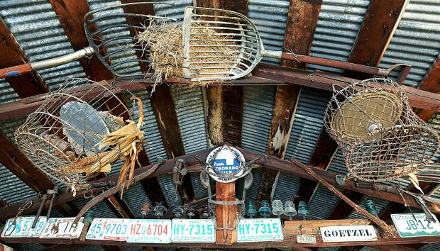 A variety of farm items is fastened to the roof of one of the Goetzels' old farm buildings. The Goetzels have been farming for 144 years in Weld County.