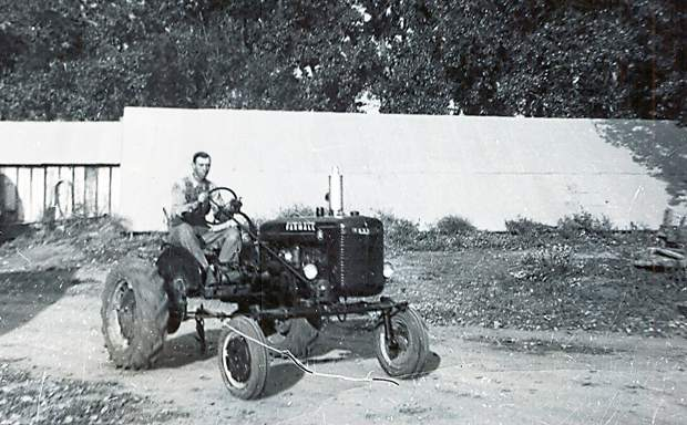 William Goetzel, father of Richard and Helen, sits in the tractor he would take his children out in to teach them about the land.