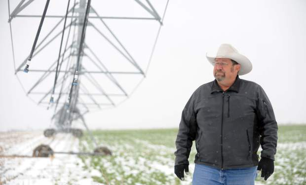 Scott Tietmeyer stands beneath the center pivot at his alfalfa field on Saturday outside Hereford.