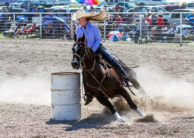 Lainie Whitmire from Marietta, Oklahoma makes a tight turn around barrel number three and heads for the timing line for an 18.48 second run at the 93rd Earl Anderson Memorial Rodeo in Grover, Colorado.