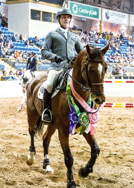 Cristian Heineking, a past winner of both the Gambler's Choice and the Grand Prix at the Stock Show, was perhaps the busiest rider at the Monarch Casino Gambler's Choice Jumper Stake during the 110th NWSS.  Heineking jumped four horses and took home three ribbons.