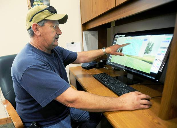 Rod Weimer farm manager at Eaton's Fagerberg Produce shows the program they use to monitor water flow in the subsurface drip irrigation system. The program can be accessed by them from anywhere with an available cell phone signal.