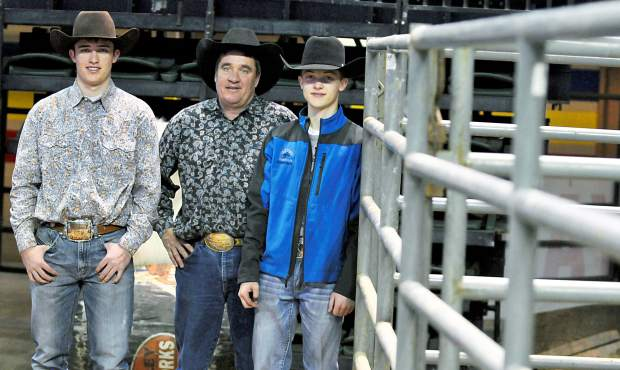 Rider Rich, 16, his father Kevin Rich, and Roper Rich, 14, stand along side a paddock for a photo on Thursday at the Budweiser Events Center in Loveland.