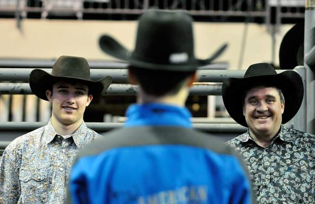 Rider Rich, 16, left, smiles as he and his father Kevin glance at his brother Roper, 14, on Thursday at the Budweiser Event Center in Loveland.
