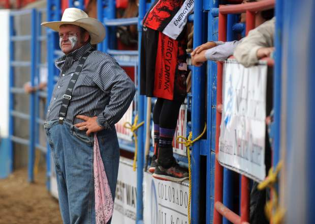 Justin Rumford stands at the chutes waiting for the next event to start Tuesday night at the Greeley Stampede rodeo in the Island Grove Arena in Greeley. While Rumford has been a rodeo clown for less than 6 years he's won the Professional Rodeo Cowboys Association clown of the year.