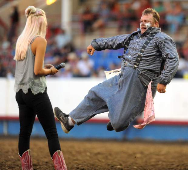 Justin Rumford dances in front of a volunteer as he does his portion of the rodeo during the Greeley Stampede Rodeo on Tuesday at Island Grove Arena.