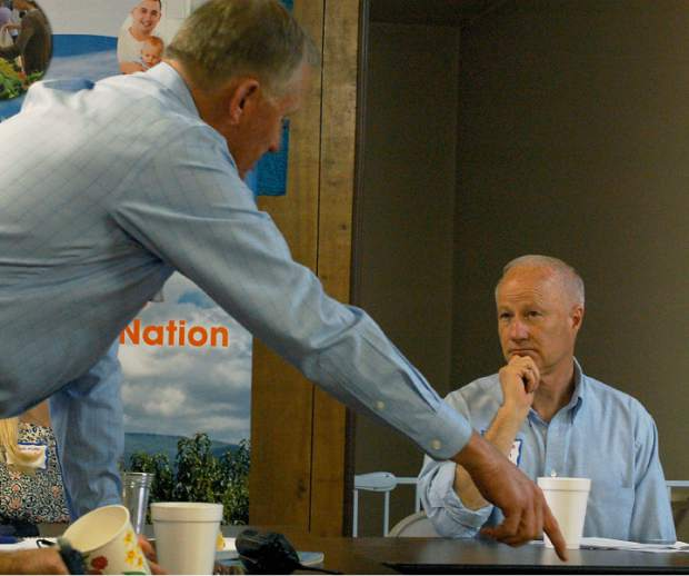 Rep. Mike Coffman, R-Colo., listens as the Colorado Commissioner of Agriculture Don Brown explains a regulation that is cumbersome to farmers. Farmers and politicians gathered Wednesday at Sakata Farms in Brighton to discuss the issues most important to ag in Colorado.