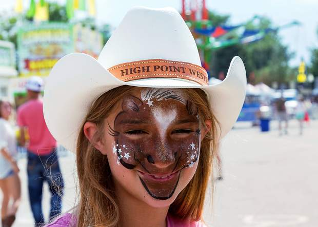 Twelve year old Savanna Vermeulen of Grover, Colorado has visited the face painting booth and now is a great looking cat.