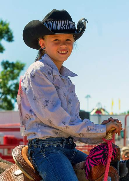 The Kids Rodeo at the Greeley Stampede is serious business to the competitors. Ashtyn Hicks participated in junior barrels, junior poles and junior flags. She did well in all events, even winning the junior poles.
