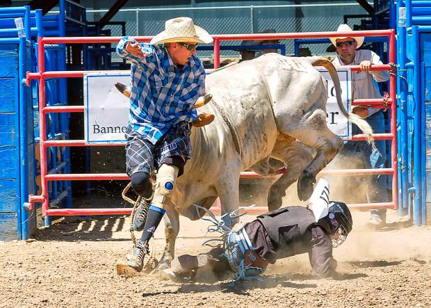 The safety of the kids is at the top of the list at the Greeley Stampede Kids Rodeo, and cowboy protector Justin Kreutzer is one of the best. Here, he risks his own body to divert an angry bull away from Tanner Moser.