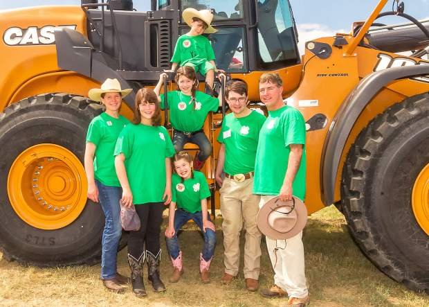 The Laffey family — Kelly and 16-year-old Sara on the left, with Audrey, 9, Jessica, 7, and 6-year-old Stephan Jr. in the middle, and Stephan and Samuel, 17, on the right — have embraced the Colorado rural lifestyle since moving from Rhode Island.