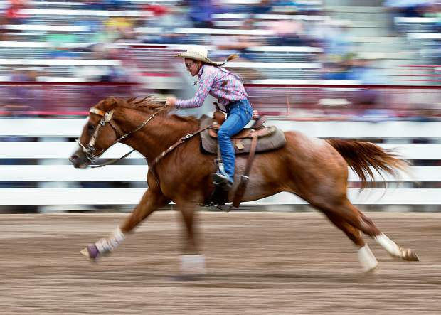 Karisa Brookshire of Lamar, Colorado pushes her horse to the timing line at the 120th Cheyenne Frontier Days.