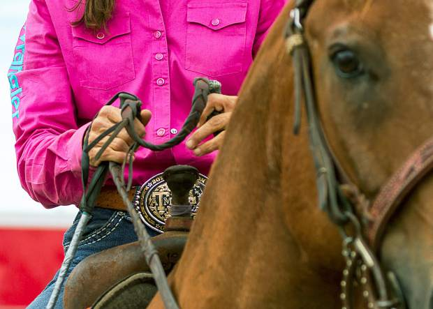 Lots of gold champion buckles on display at  Cheyenne Frontier Days Barrel Racing Slack as the best in the country gather to compete for the coveted CFD gold Buckle.