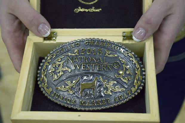 Miss Rodeo Colorado, Marie Louise Kidd, holds the belt buckle reserved for the show champion.