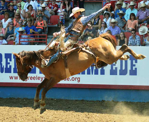 Tyrel Larsen rides the horse, Ole Flame, to earn 81 points in the PRCA Pro Rodeo Finals on Saturday afternoon at the Greeley Stampede. Larsen tied for first in the saddle bronc riding with Issac Diaz.