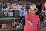 Carol Zadrozny helps a customer find their favorite kind of peach earlier this year at the Palisade Farmers Market. Zadrozny was instrumental in starting the farmers market in downtown Palisade.