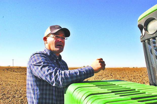 Marc Arnusch grows a variety of crops on his farm, from corn to sugar beets to alfalfa to certified seed wheat and barley. He has worked to stay profitable in times of market downturn by bringing in value-added crops, sush as wheat for seed and barley, which is a boon for the craft beer industry.