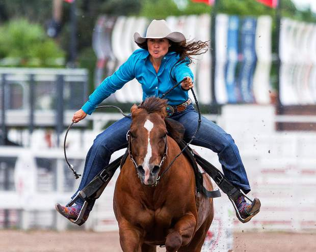 Erin Wanner of Dickenson, N.D., urges the last second of speed out of her horse to be one of those that move on from Slack to the perfs at the 120th annual Cheyenne Frontier Days.