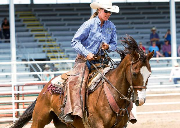 Jessica Mosher from Karval, Colorado is a member of the pick-up team for the Colorado Championship Ranch Rodeo in Hugo, Colorado and a WRCA World Champion Bronc Rider.