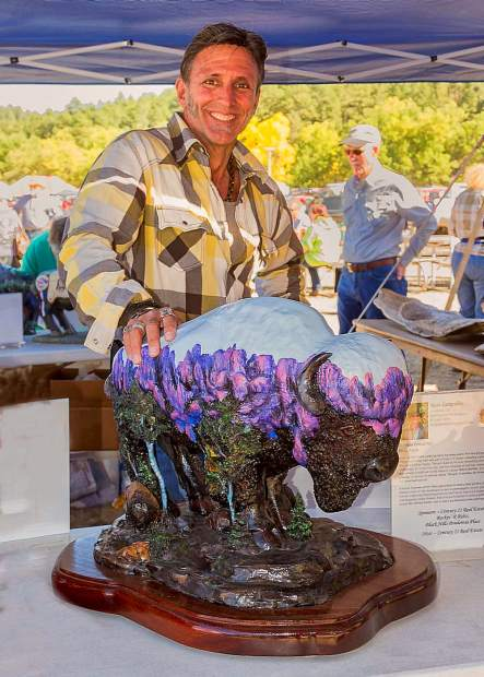The film crew of Richard Weis' Born to Explore has a good eye for distinctive art as they interview Lampshire during the ABC coverage of the 2012 Custer Buffalo Roundup and Arts Festival.