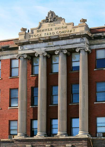 The neoclassical Denver Union Stock Yard Company Building with its four, three story tall ionic columns housed the Livestock Exchange and The Stockyard National Bank. This part of the building was completed in 1916 and the Colorado Brand Inspectors had their offices there from 1917 to 2015.