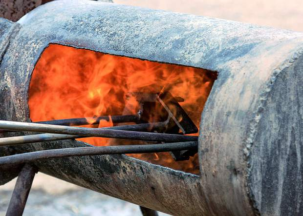 Propane heats the branding irons of Harry Vold's Ranch along the Huerfano River, southeast of Pueblo, Colorado. The three iron Bar-H-V brand has been on the hip of elite PRCA World Champion bucking horses and bulls.