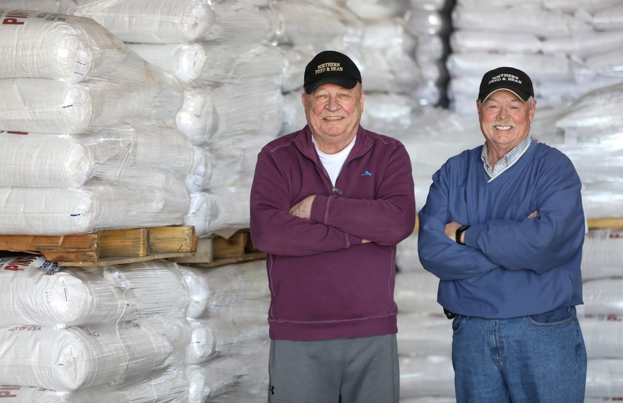 Owner Larry Lande, right, stands next to former owner Bob Brunner whose dad founded the company, Northern Feed and Bean in 1952 in Gill, Colo., the company moved to Lucerne in 1991 but still use the Gill location for storage they also have operated facilities in Ault and Torriangton, Wyo.