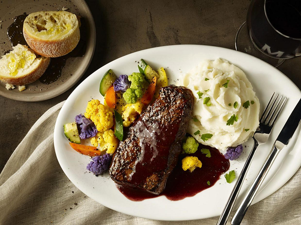 Maggiano's Little Italy restaurants currently offers an eight-ounce Denver steak with potatoes and vegetables for less than $25.00.