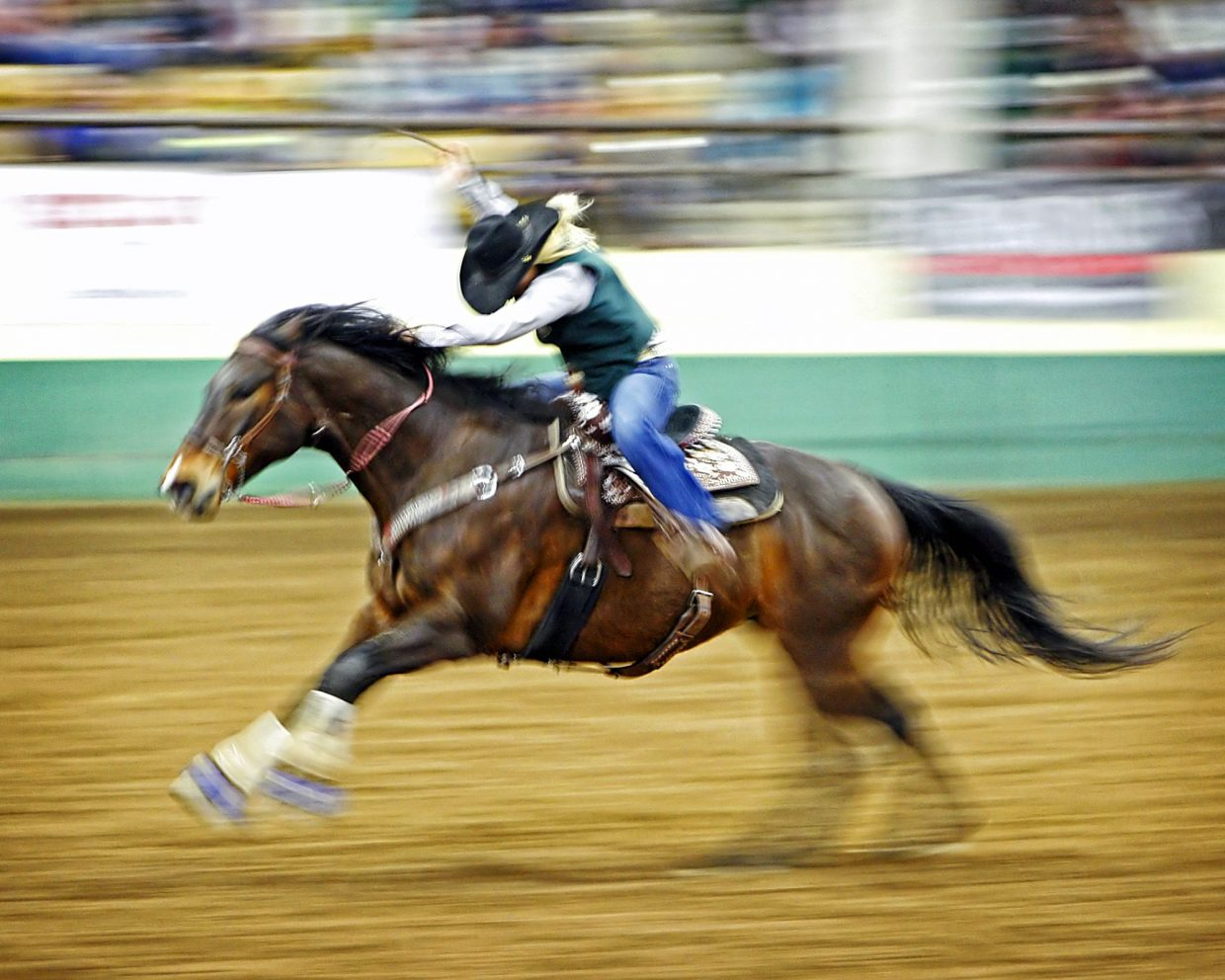 Colorado State University barrel racer, Lake Mehalic, Tucson, Ariz., sprinted for the timers aboard 12-year-old Big Brown on her way to a 14.76-second run on Saturday night. The time was good enough to send Mehalic into Sunday's short go, where she won the round and the average title at the CSU rodeo.