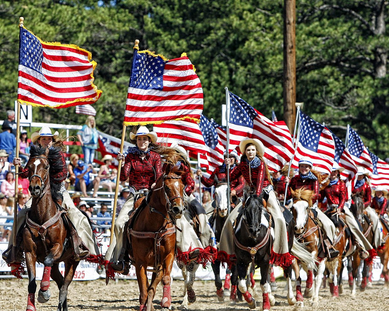 Riders in the Blazing Saddles drill team put on a patriotic show for an appreciative audience near the conclusion of June 4's Red, White & Blue Rodeo at the 2017 Elizabeth Stampede in Elizabeth, Colo.