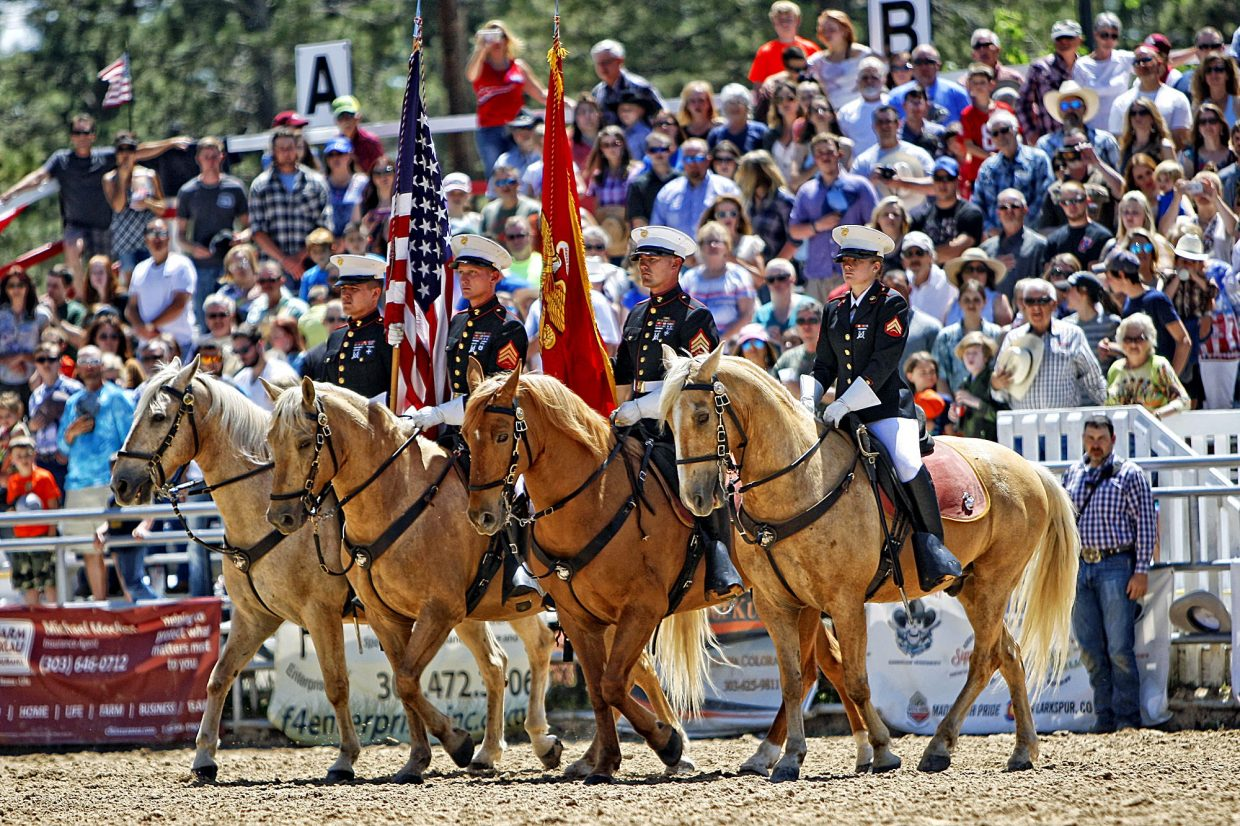 The Marine Corps Mounted Color Guard has been a fixture in Elizabeth's Red, White & Blue Rodeo for years, much to the delight the packed grandstands.