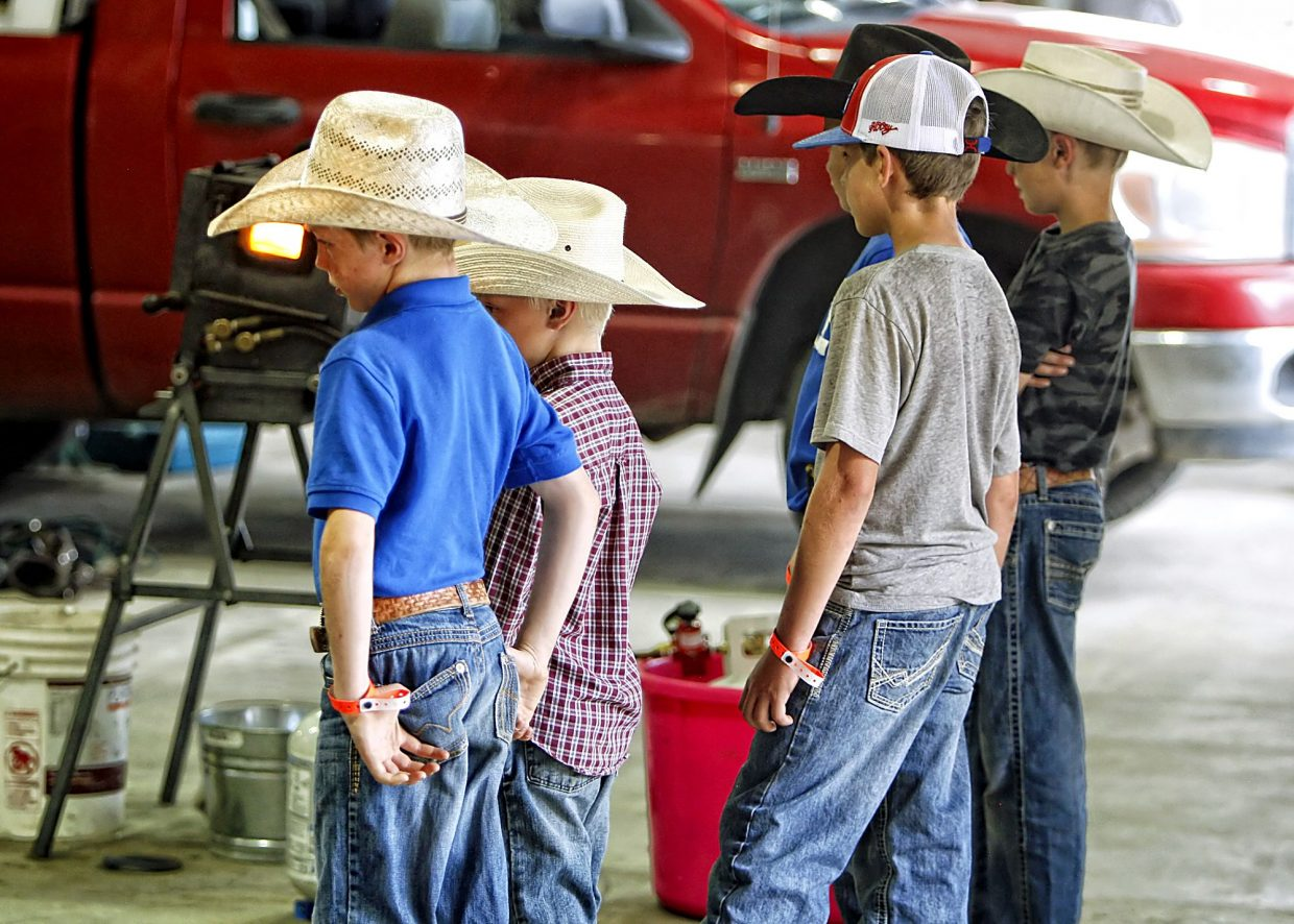 The sight and sounds of the Rock'n Western Rendezvous' ferrier competition on Friday afternoon (June 2, 2017) drew the next generation of cowboys like moths to a flame.