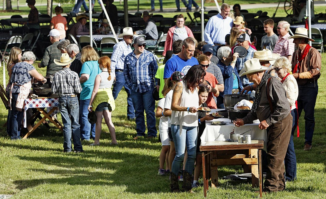 If you have a western event, you better have chuckwagon cooking. The crowd showing up for the third annual Rock'n Western Rendezvous in Loveland, Colo., was happy to line up for a dinner served up by Colorado chuckwagons during a beuatiful Friday night on June 02, 2017.