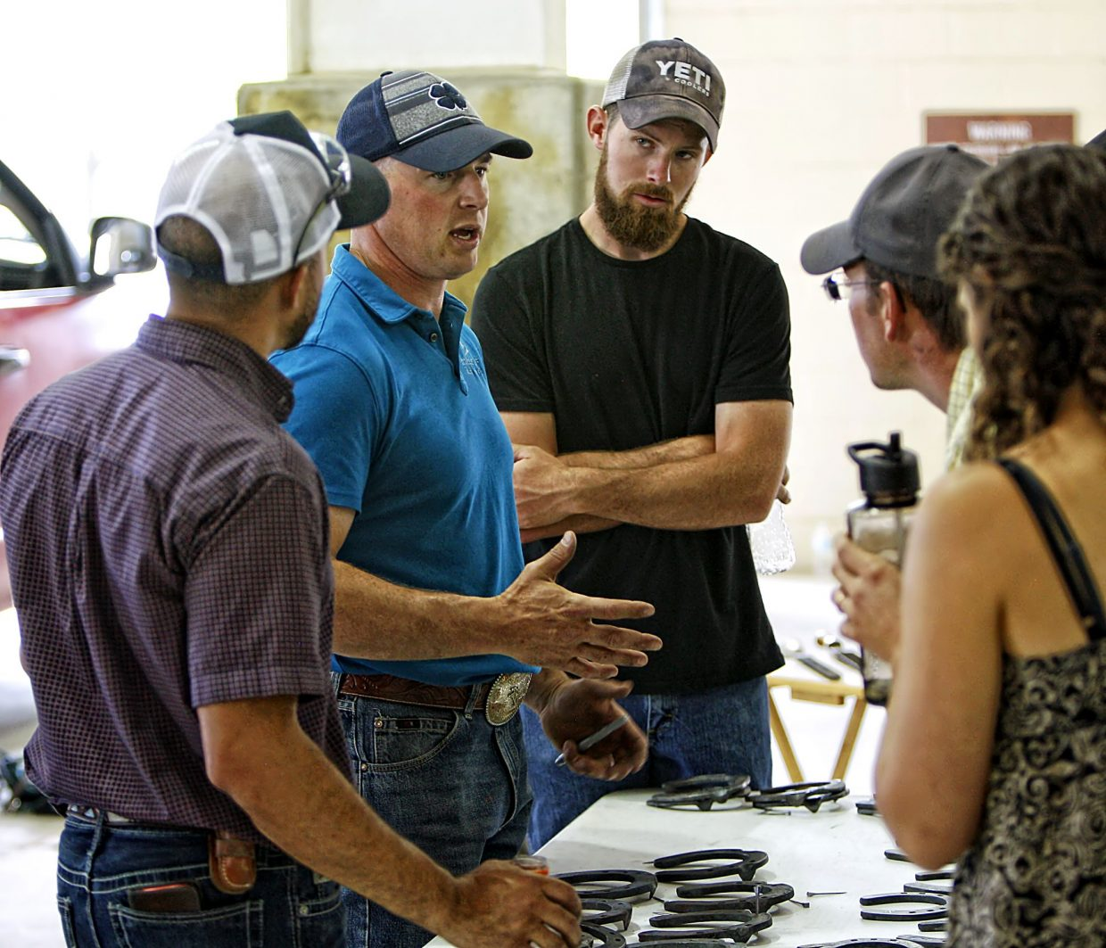 Kyd Kelley from Three Forks, Mont., (second from left) a journeyman ferrier and a tester with the American Ferriers Association, judged the ferrier competition at the third annual Rock'n Western Rendezvous in Loveland, Colo., (June 02-03, 2017). In this photo, Kelley discusses the work turned in by some of the 16 ferrers during the competition.