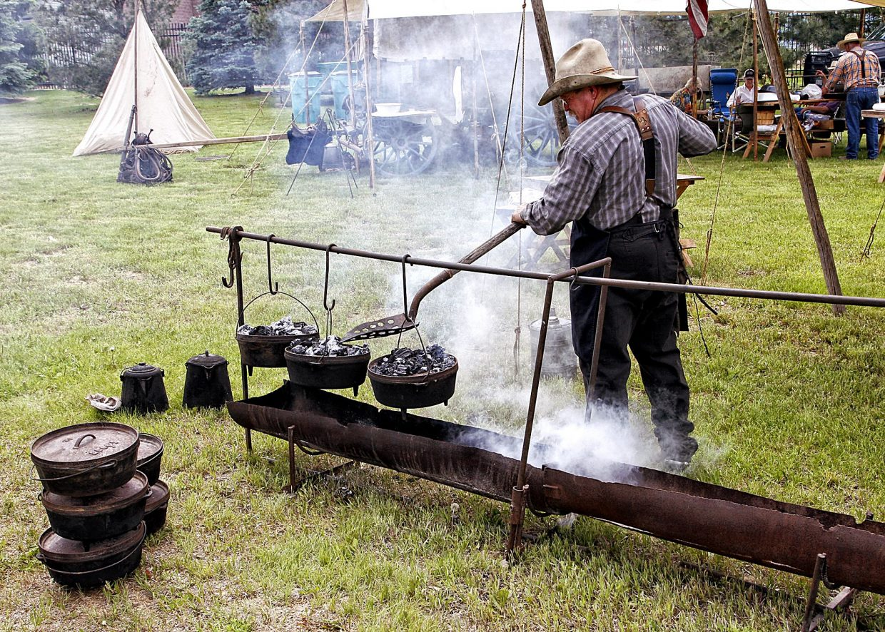 John Schaffner (Wray, Colo.) worked to get his dutch ovens heated as he prepared beef tips, biscuits, cowboy hashbrowns and cobbler for the expected 100-plus people who would be showing up to eat chuckwagon cooking at the 2017 Rock'n Western Rendezvous in Loveland, Colo. Schaffner has been chuckwagon cooking for 20 years.