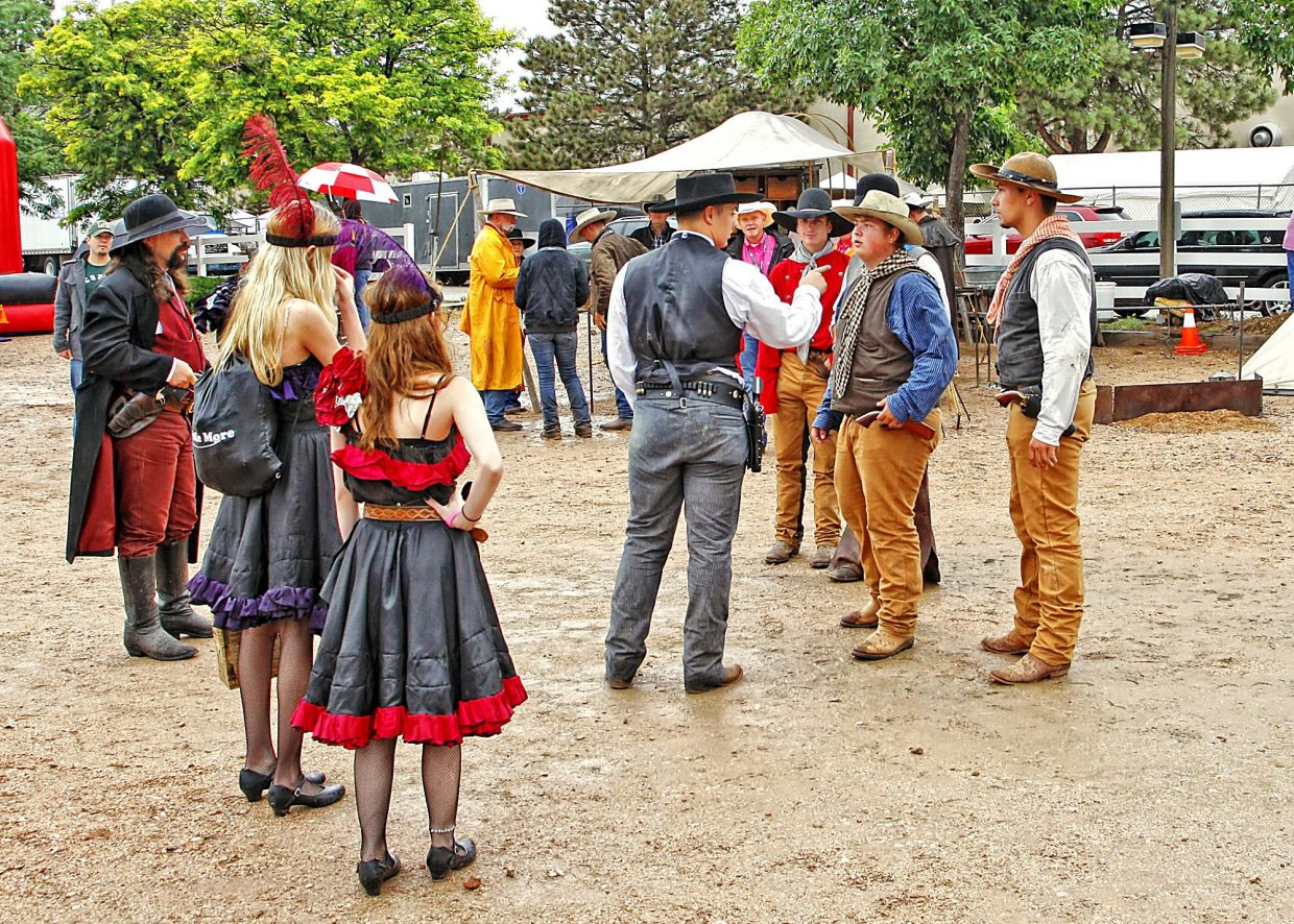 The 2017 Pikes Peak or Bust Rodeo in Colorado Springs had an outdoor fan zone where the entertainment included old west reenactors who wandered the grounds while occasionally confronting each other in a contest of law and order versus outlaw elements.